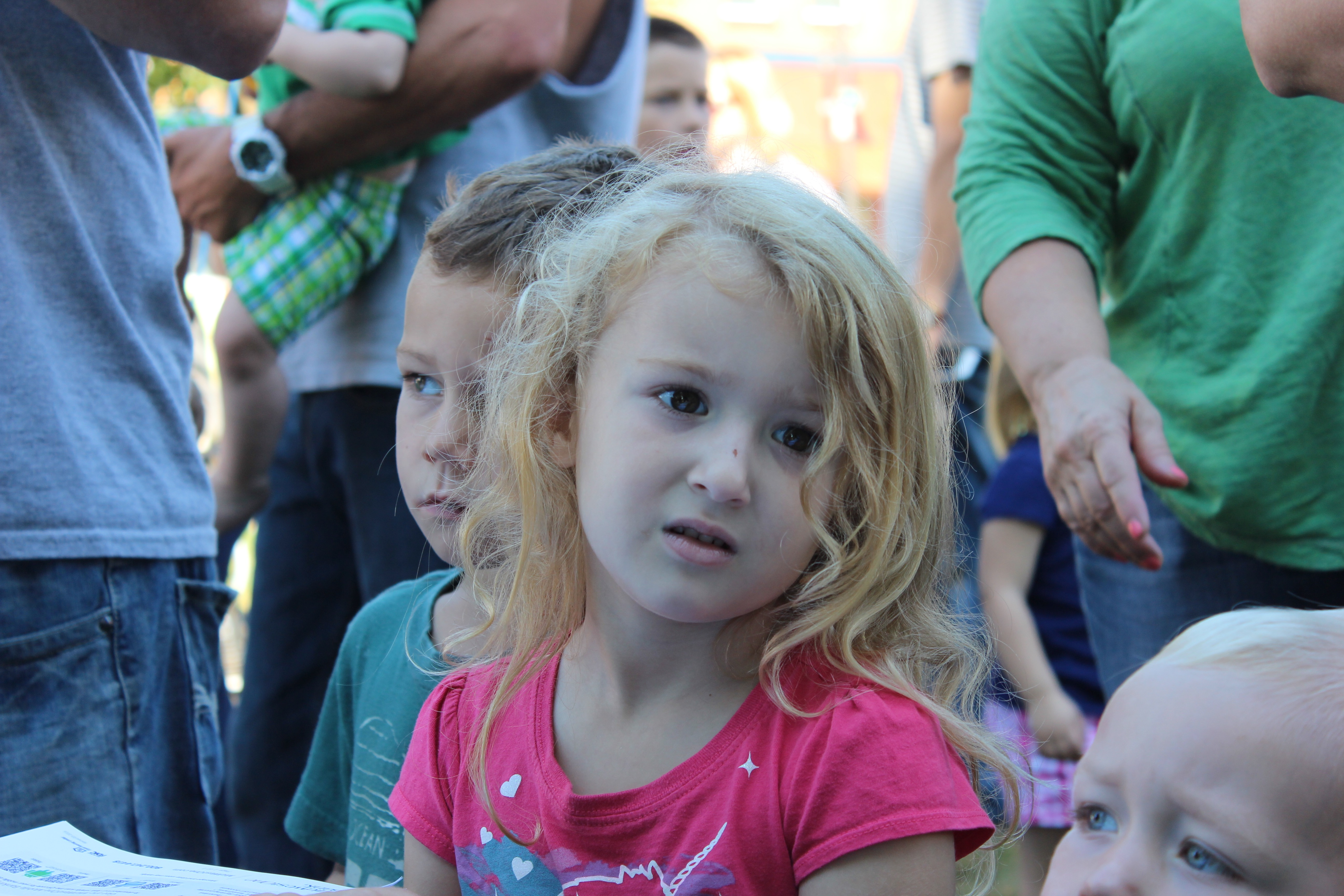 Waiting patiently for a balloon at the Kiwanis Kids' Day on the square
